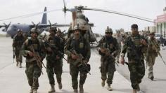 Afghan security forces arrive at the Kunduz airport