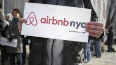 Supporters of Airbnb rally before a hearing at City Hall in New York