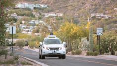 Test drivers use a Lexus SUV, built as a self-driving car, to map the area before a journey without a driver in control, in Phoenix