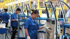 Employees work at a production line inside a factory of Saic GM Wuling, in Liuzhou, Guangxi Zhuang Autonomous Region, China, June 19, 2016. REUTERS/Norihiko Shirouzu - RTSILVN