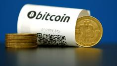 FILE PHOTO - A Bitcoin (virtual currency) paper wallet with QR codes and a coin are seen in an illustration picture taken at La Maison du Bitcoin in Paris, France, May 27, 2015. To match Special Report BITCOIN-WRIGHT/PATENTS     REUTERS/Benoit Tessier/Fi