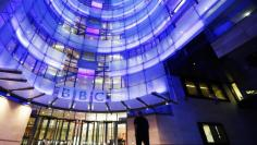 FILE PHOTO - A man enters BBC New Broadcasting House in London