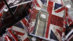Union flags and the Big Ben clocktower cover notebooks are seen on sale in London, Britain, Thursday  December 17, 2015.  REUTERS/Luke MacGregor