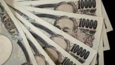 A picture illustration shows Japanese 10,000 yen notes featuring a portrait of Yukichi Fukuzawa, the founding father of modern Japan, taken in Tokyo August 2, 2011.  REUTERS/Yuriko Nakao/File Photo
