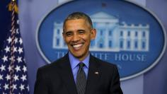 Obama smiles as he holds his end of the year news conference at the White House in Washington
