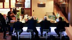 FILE PHOTO: Participants sit at a bar during the annual meeting of the World Economic Forum (WEF) in Davos, Switzerland