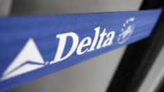 Delta airline name tags are seen at Delta terminal in JFK Airport in New York, July 30, 2008. REUTERS/Joshua Lott