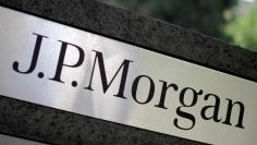 The logo of Dow Jones Industrial Average stock market index listed company JPMorgan Chase (JPM) is seen in Los Angeles, California, United States, in this October 12, 2010 file photo. JPMorgan Chase & Co. owns Chase Commerical Bank and JPMorgan Investment