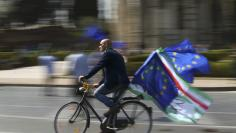 A protestor rides his bicycle during a pro-EU demonstration as European Union leaders meet on the 60th anniversary of the Treaty of Rome, in Rome