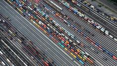Containers and cars are loaded on freight trains at the railroad shunting yard in Maschen near Hamburg September 23, 2012.  REUTERS/Fabian Bimmer/File Photo
