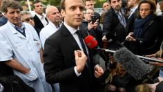 Emmanuel Macron, head of the political movement En Marche !, or Onwards !, and candidate for the 2017 French presidential election, speaks to journalists during a visit to the Hospital Raymond-Poincare in Garches