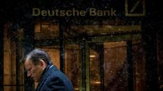 Scratches are seen on the logo of Germany's Deutsche Bank in Frankfurt, Germany, January 26, 2016. REUTERS/Kai Pfaffenbach