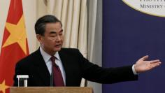 Chinese Foreign Minister Wang Yi addresses the media during a news conference following his meeting with Greek Foreign Minister Nikos Kotzias at the Foreign Ministry in Athens