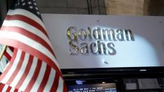 FILE PHOTO:  A view of the Goldman Sachs stall on the floor of the New York Stock Exchange in New York, U.S., July 16, 2013.     REUTERS/Brendan McDermid/File Photo