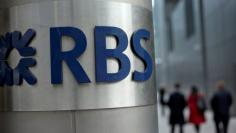 FILE PHOTO: FILE PHOTO: People walk past a Royal Bank of Scotland office in London, Britain, February 6, 2013.    REUTERS/Neil Hall/File Photo - RTS133EC/File Photo