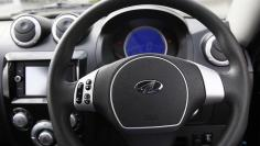 The steering wheel of a Mahindra e2o electric car is seen in London