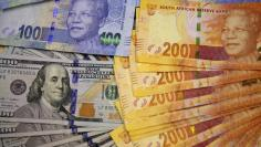 American dollar notes are displayed in this photo illustration in Johannesburg August 13, 2014.  REUTERS/Siphiwe Sibeko