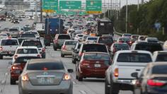 Rush hour traffic is shown on Interstate 95 near downtown Miami, Florida