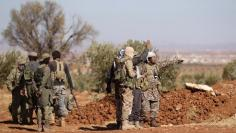 Rebel fighters gather during their advance towards the Islamic State-held city of al-Bab