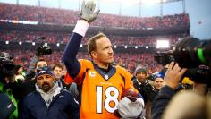 Jan 24, 2016 File photo; Denver, CO, USA; Denver Broncos quarterback Peyton Manning (18) waves to the crowd after the AFC Championship football game against the New England Patriots at Sports Authority Field at Mile High. Mandatory Credit: Mark J. Rebilas