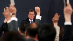 South Korean President Moon Jae-in attends his New Year news conference at the Presidential Blue House in Seoul, South Korea, January 10, 2018.  REUTERS/Kim Hong-Ji