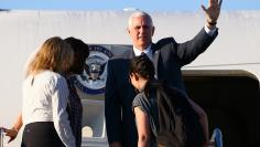 U.S. Vice President Mike Pence looks at a kangaroo called Penny with his wife Karen (L) and their daughters Audrey (2nd R) and Charlotte during a visit to Taronga Zoo in Sydney, Australia, April 23, 2017. REUTERS/Peter Parkes/Pool