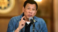FILE PHOTO: Philippine President Rodrigo Duterte announces the disbandment of police operations against illegal drugs at the Malacanang palace in Manila, Philippines early January 30, 2017.    REUTERS/Ezra Acayan/File Photo