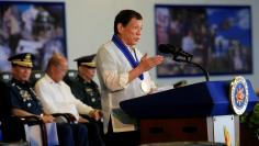 Philippines' President Rodrigo Duterte gestures as he talks to the troopers during his visit to Camp Teodulfo Bautista in Jolo, Sulu, Philippines