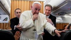 Pope Francis talks to journalists during a press conference on his return flight from Cairo to Rome