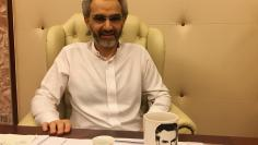 FILE PHOTO - Saudi Arabian billionaire Prince Alwaleed bin Talal sits for an interview with Reuters in the office of the suite where he has been detained at the Ritz-Carlton in Riyadh, Saudi Arabia