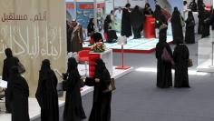 File photo of jobseekers standing in line to talk with recruiters during a job fair in Riyadh