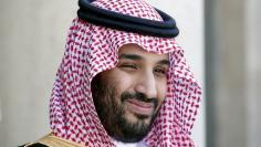 Saudi Arabia's Deputy Crown Prince Mohammed bin Salman reacts upon his arrival at the Elysee Palace in Paris