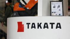 An attendant walks at a Takata Corp display in a showroom for vehicles in Tokyo, Japan February 5, 2016. REUTERS/Toru Hanai - RTX25K52