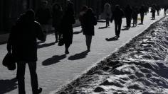 People walk on street during sunny frosty day in central Kiev