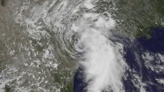 The center of Tropical Storm Bill is seen making landfall on Matagorda Island, Texas