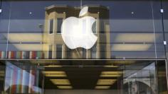 The Apple logo is pictured on the front of a retail store in the Marina neighborhood in San Francisco, California April 23, 2014. The company is set to announce its first quarter earnings. REUTERS/Robert Galbraith  (UNITED STATES - Tags: BUSINESS SCIENCE