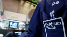 FILE PHOTO:  A trader works at the Goldman Sachs stall on the floor of the New York Stock Exchange, New York, U.S. on April 16, 2012.  REUTERS/Brendan McDermid/File Photo