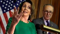 U.S. House Minority Leader Nancy Pelosi (D-CA) speaks next to Senate Minority Leader Chuck Schumer (D-NY) during a news conference on President Trump's first 100 days on Capitol Hill in Washington, U.S April 28, 2017. REUTERS/Yuri Gripas