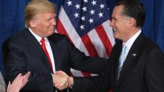 Donald Trump and Mitt Romney shake hands after Trump endorsed his candidacy for president, February 2, 2012.  REUTERS/Steve Marcus