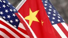 FILE PHOTO: Chinese and U.S. flags fly along Pennsylvania Avenue outside the White House in Washington January 18, 2011. REUTERS/Kevin Lamarque
