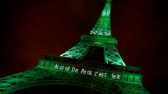 """FILE PHOTO: The Eiffel tower is illuminated in green with the words """"Paris Agreement is Done"""", to celebrate the Paris U.N. COP21 Climate Change agreement in Paris, France, November 4, 2016. REUTERS/Jacky Naegelen/File Photo"""