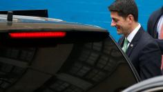Paul Ryan, Speaker of the United States House of Representatives, gets into his vehicle as he departs Public School 162 in the Harlem area of New York, U.S. May 9, 2017.   REUTERS/Carlo Allegri