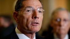 FILE PHOTO: Senator John Barrasso (R-WY) speaks during a press conference on Capitol Hill in Washington, U.S., September 12, 2017.   REUTERS/Joshua Roberts