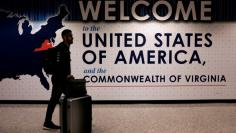 FILE PHOTO: An international passenger arrives at Washington Dulles International Airport in Virginia