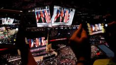 Republican presidential nominee Donald Trump is seen on video monitors as people take photographs during the Republican National Convention in Cleveland, Ohio