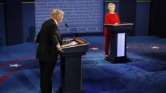 Republican U.S. presidential nominee Trump speaks as Clinton listens during presidential debate at Hofstra University in Hempstead
