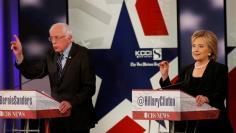 Democratic U.S. presidential candidates former Secretary of State Hillary Clinton and Senator Bernie Sanders discuss a point during the second official 2016 U.S. Democratic presidential candidates debate in Des Moines, Iowa, November 14, 2015.         REU
