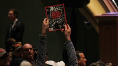 File Photo: A man holds up a copy of Time Magazine in Des Moines, Iowa January 28, 2016. REUTERS/Rick Wilking