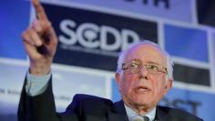 U.S. Democratic presidential candidate Bernie Sanders speaks during the First in the South Dinner in Charleston