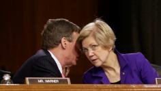 """Senators Mark Warner (D-VA) and Elizabeth Warren (D-MA) speak before Federal Reserve Chair Janet Yellen testifies before a Senate Banking, Housing, and Urban Affairs Committee hearing on the """"Semiannual Monetary Policy Report to the Congress"""" on Capi"""